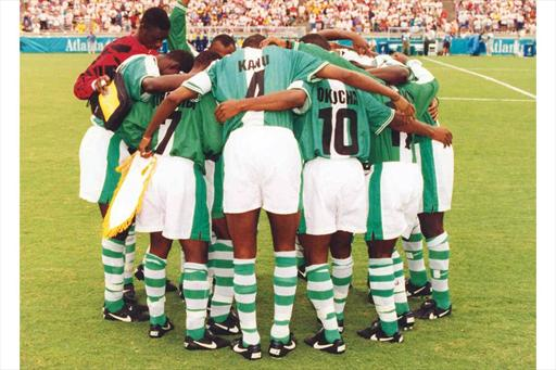 Nigerian Olympic soccer team in a huddle before a game